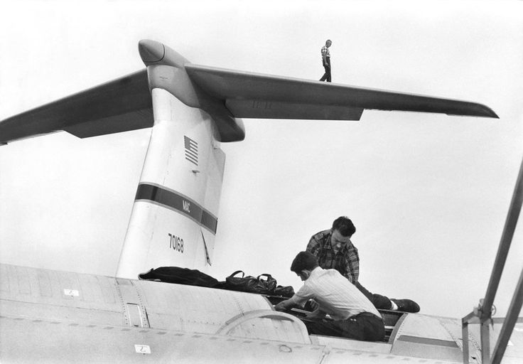 """livelymorgue:  Putting together the C-5 Galaxy, one of the world's largest aircraft, at a Lockheed plant in Marietta, Ga., in October 1969. On Dec. 18 of that year, The Times announced that this """"controversial C-5 transport, with a cargo area longer than the flight by the Wright Brothers' tiny plane 66 years ago, was formally turned over to the Air Force today on the anniversary of powered flight."""" Photo: George Tames/The New York Times"""