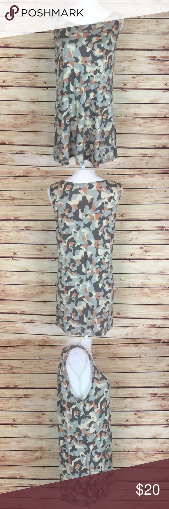 "LOGO Lounge Camo Tank Top Tunic Gray Cream Large LOGO Lounge tank top tunic. Gray, cream, and a pink-ish color camo like print. Sleeveless. Scoop neck. Large.  Excellent preowned condition with no flaws. Originally came with a shirt that went over the top which is missing.  Measurements are approximately: 36"" bust, 39"" waist, and 30"" length.  95% rayon 5% spandex.  No trades. All items come from a pet friendly home. Bundle to save! LOGO Tops Tunics"