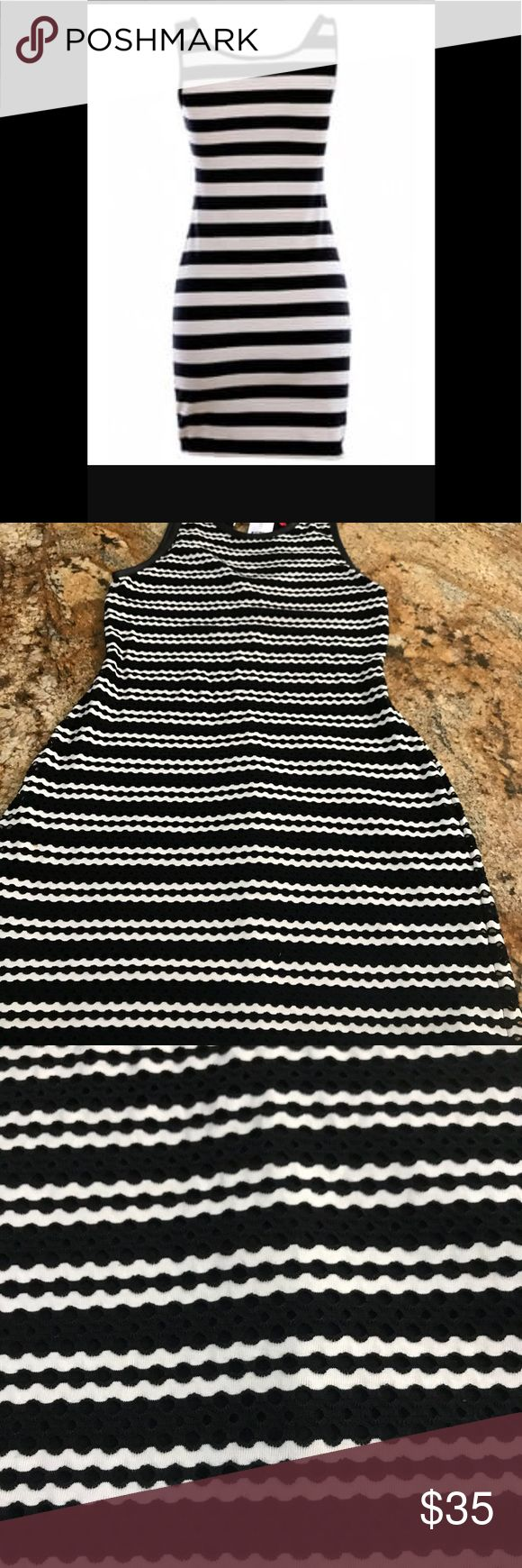 Saks Off 5th Stripe Bodycon Dress New, beautiful dress with leather accents in the sleeve cut outs and neck. Dresses