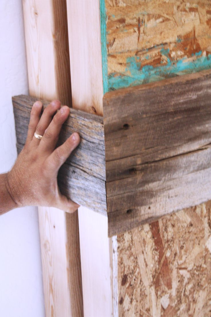 """Step 7 - For the edges, angle the ends of the wood so they fit together and come to an edge like this photo. For the sides of the frame, nail pieces of reclaimed wood directly to the 2 x 4s. To make a removable """"door"""" on one side of the frame to access your cable box, simply nail two or three pieces of reclaimed wood together using two crossbars of wood. Secure this to the side of the frame using a latch of your choosing. When you are ready to access the cable box, simply undo the latch and…"""
