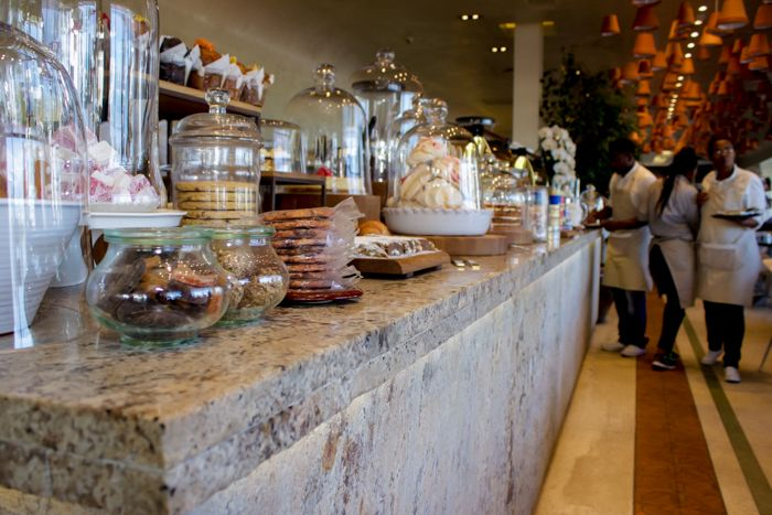 Granite with a matte finish (honed, leathered or flamed) can create a stunning effect.  We love how the tashas eatery at the V&A Waterfront in Cape Town has used a LED lighting strip under the lip of the countertop. Get your textured granite surface from www.rudischoice.co.za in South Africa and Zimbabwe.