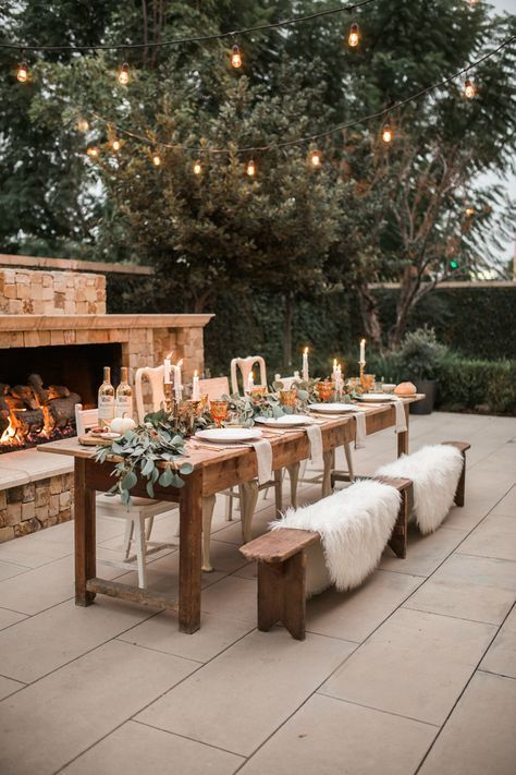 Thanksgiving Tablescape, fur rugs, brass candlesticks, amber goblets