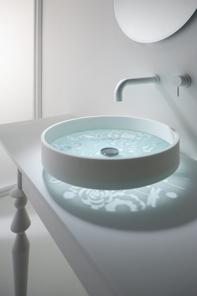Motif Basin by Thomas Coward for Omvivo The Motif is a sophisticated and subtle way to add a pattern into your bathroom using hand-etched designs. Each Motif basin is created with hand-etched glass fitted into a solid surface and polished with a chrome plug and spacer. The design's reflection creates a striking pattern on the surface of the counter.