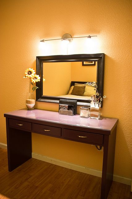 Chi's Vanity - DIY inspiration! Paint the counter top of an old wooden vanity a unique color (turquoise or lavender would be lovely!) and gloss it up, or lay a sheet of glass over it.