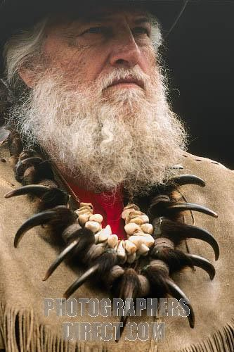 Mountain Man Clothing | Stock Photography image of Bearded mountain man wearing a grizzly bear claw necklaces