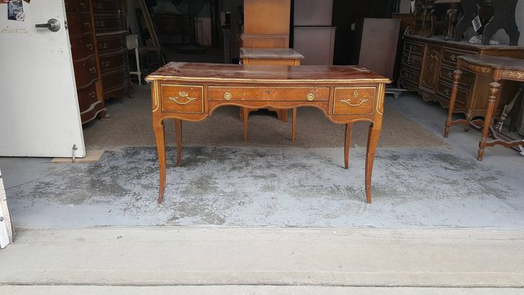 $299.00 Measures 51 wide by 25 deep and 30 tall. PICK UP ONLY, WE DO NOT SHIP $299.00 Vintage vanity. Beautiful french style desk, add mirror and it becomes a vanity. In great shape. All drawers open and close nicely. It has beautiful ornate lines. Large work surface area. Measures 51 wide by 2