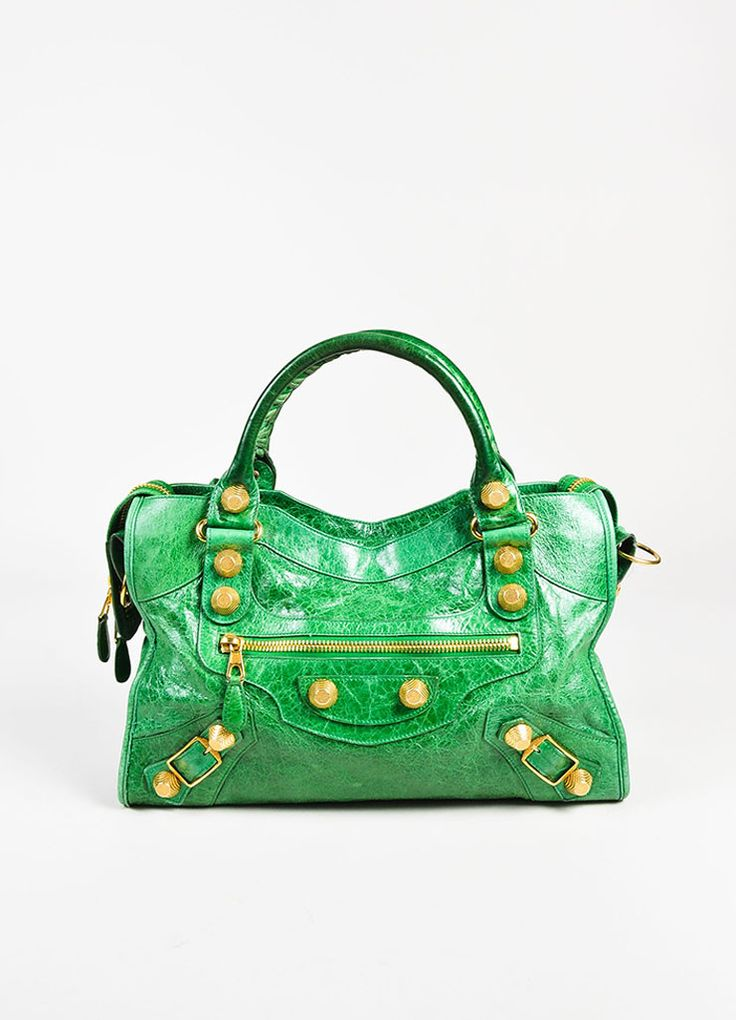 "Balenciaga ""Giant 21 City"" green leather two-way bag. Features gold toned hardware, including buckles on each front side and studs throughout front and back. Small zipper pocket on front middle. Carry"