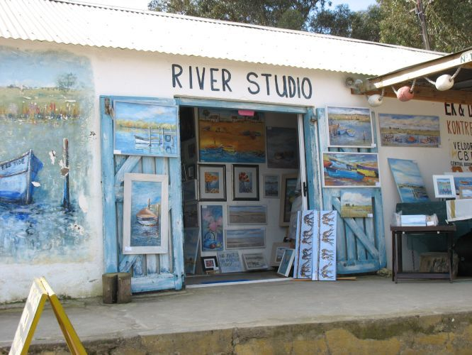 A local artist in Velddrif paints at The River Studio in Velddrif, Cape West Coast http://exclusivegetaways.co.za/2014/09/08/boats-bokkoms-and-good-cheer-on-tap-at-velddrif-on-the-capes-west-coast/