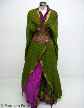 GANGS OF NEW YORK - Harlot's Kimono Outfit: three kimonos (green and magenta silk; woven striped green with gold thread accents and split back and long-sleeve purple silk kimono with magenta and black trim and thin lime stripes) held close to the body by an embroidered corset with a lace-up closure in the back. Under the kimonos a skirt with ruffles, a blouse and floral print short-sleeve shirt made from sheer cotton, has a string tie around the collar and cuffs.