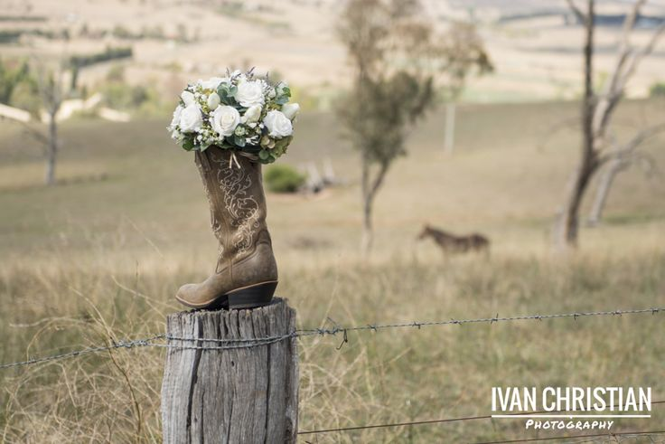 Bridal bouquet with the brides wedding boots! - Ivan Christian Photography