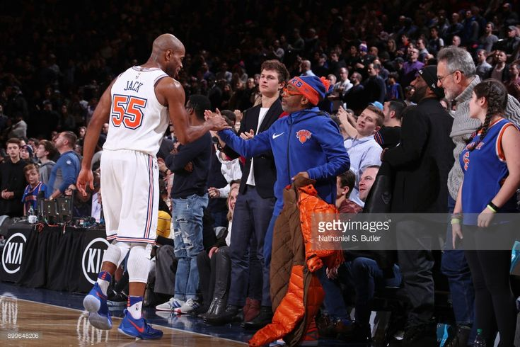 Jarrett Jack #55 of the New York Knicks shakes hands with Film Director Spike Lee during the game against the Oklahoma City Thunder on December 16, 2017 at Madison Square Garden in New York City, New York.