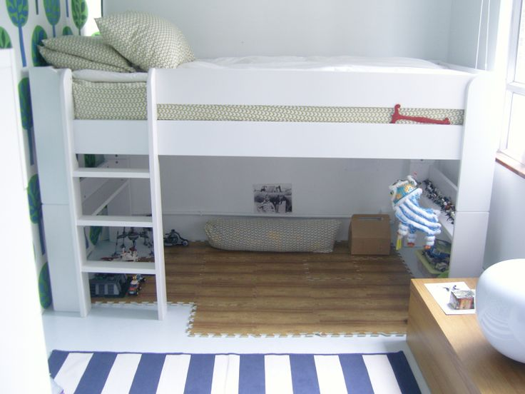 a very small kids room with a brilliant Danish bed.