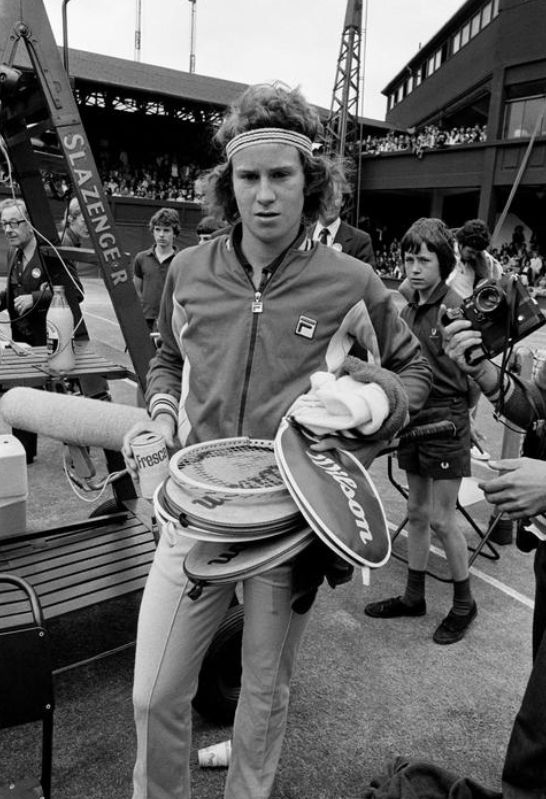 John McEnroe during his first appearance at Wimbledon in 1977. A Qualifier, McEnroe made an improbable run to the semi-finals where he was eventually bundled out by the top seeded Jimmy Connors.