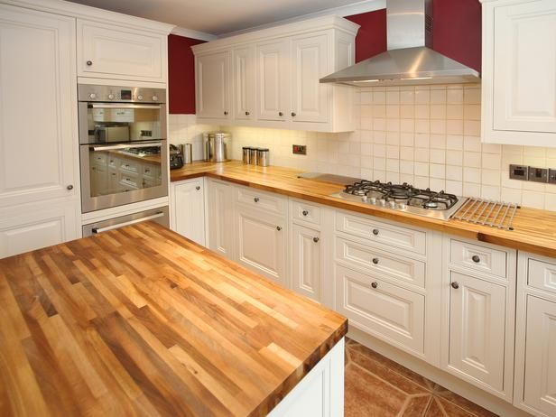 Butcher Block Kitchen Countertops. just watched property brothers use this!