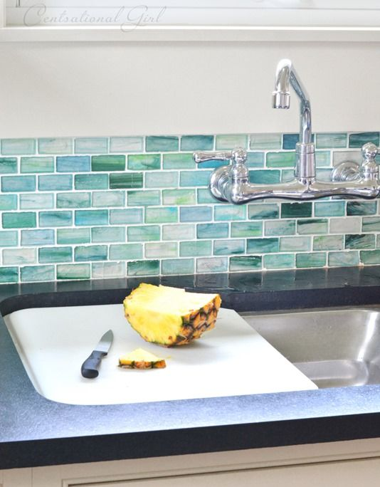 This gorgeous tile backsplash gives the impression of water, perfect for a  coastal home. The sink with cutting board ledge is also a fantastic idea,  ... - 25+ Best Ideas About Glass Tile Backsplash On Pinterest Subway