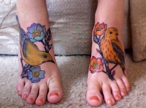.Awesome pair of bird tattoos.