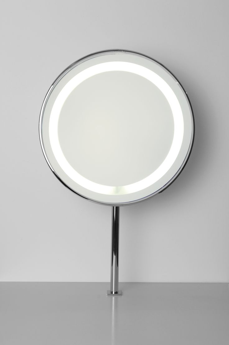 """betec """"Discus"""" mirror LED-light. An extravagant yet elegant design. The LED ring light envelopes your face in a flattering albeit honest fashion. A prominent form lends you a certain distinction. It seem entirely becoming that this mirror image only tolerates your figure. Whether as a free-standing or wall mirror, the light reaches its opposite. Thanks to its dimmer switch and ballast, the light can be steadily regulated."""