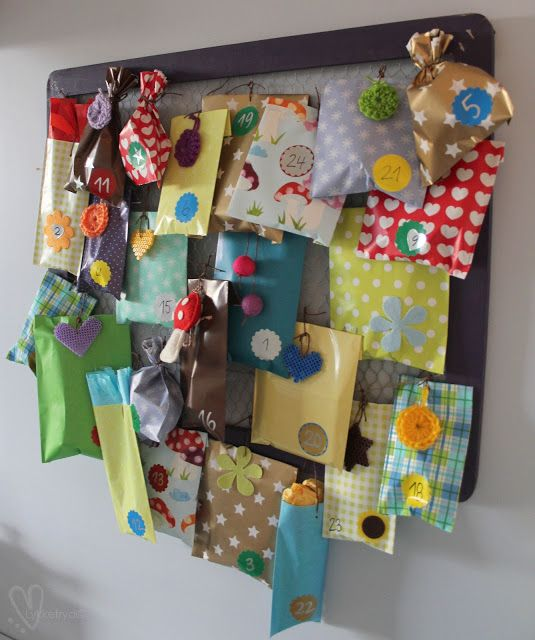 colorful package advent calendar - cute felted balls,  hama bead, and crocheted dangles for decorations
