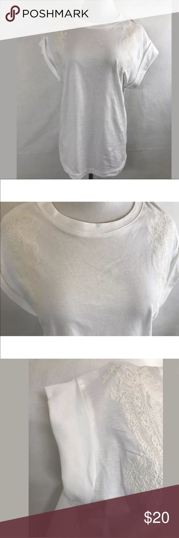 """H&M White Short Sleeves Boho Embroidery Top H&M White 100% Cotton Short Sleeves Top Ivory Boho Embroidery Size M Medium. Folded sleeves.  Shell: 100% Cotton Embroidery: 100% Polyester  Length (Shoulder to Hem) - 23.5"""" Armpit to Armpit - 16.5"""" **All measurements are approximate** H&M Tops Blouses"""