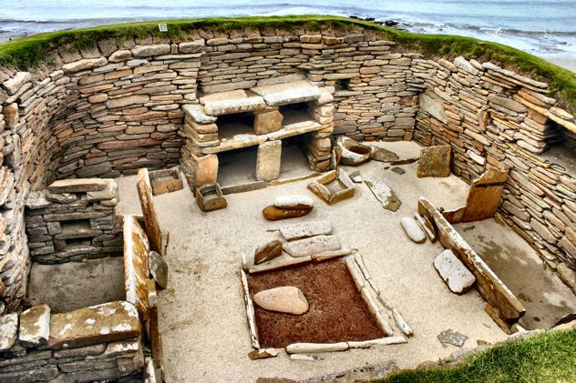 """Skara Brae is a stone Neolithic settlement on the island of Mainland in the Orkneys.   It was inhabited from roughly 3150 to 2500 B.C.  It is the most intact Neolithic settlement in Europe, gaining it UNESCO World Heritage Site status and the nickname of """"Scottish Pompeii""""."""
