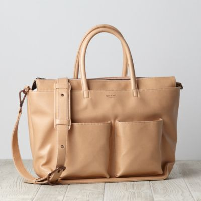 You don't have to sacrifice style in a diaper bag to have more space. Our exclusively designed Matt & Nat Diaper Bag has lots of both. It even doubles as a tote. Available in a variety of colors, the bag is made of faux leather.