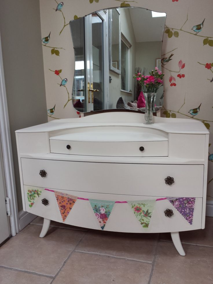 I painted this 1950s dressing table with Annie Sloan Chalk Paint 'Old White' and decoupaged the bunting 'hanging' out of the bottom drawer. I sell handpainted upcycled furniture on facebook. www.facebook.com/vintagefortday