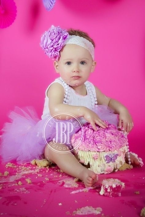 A Pretty knee length Tutu with satin bow and matching HeadpieceSize 1
