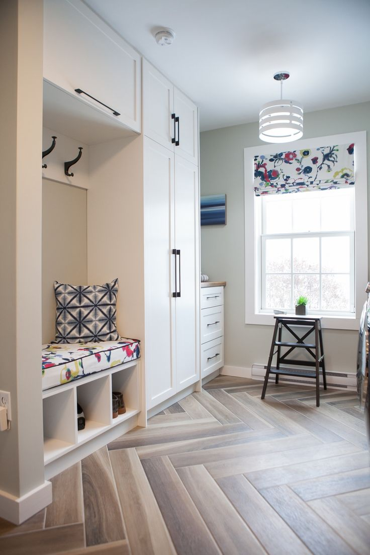 This modern laundry room truly show's how much excitement can be introduced into a small space. This multi-purpose room triples as a mud room coming in from the garage, a laundry room and a powder room. A wood look ceramic tile laid in a herringbone pattern gives a burst of interest next to the simple... View Article