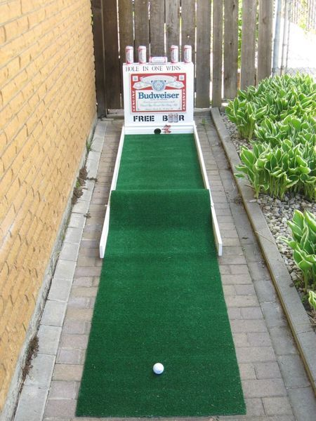 hole in one wins you a free beer, $1 per try.