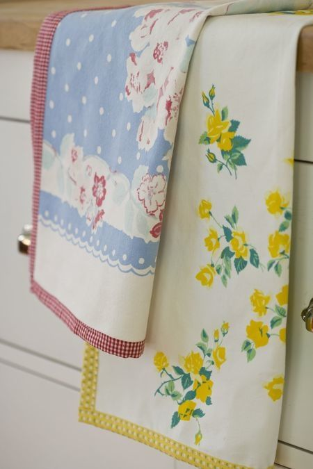 Dish towels made from vintage tablecloths. This is a good use for tablecloths that are stained or otherwise damaged but still have good sections.