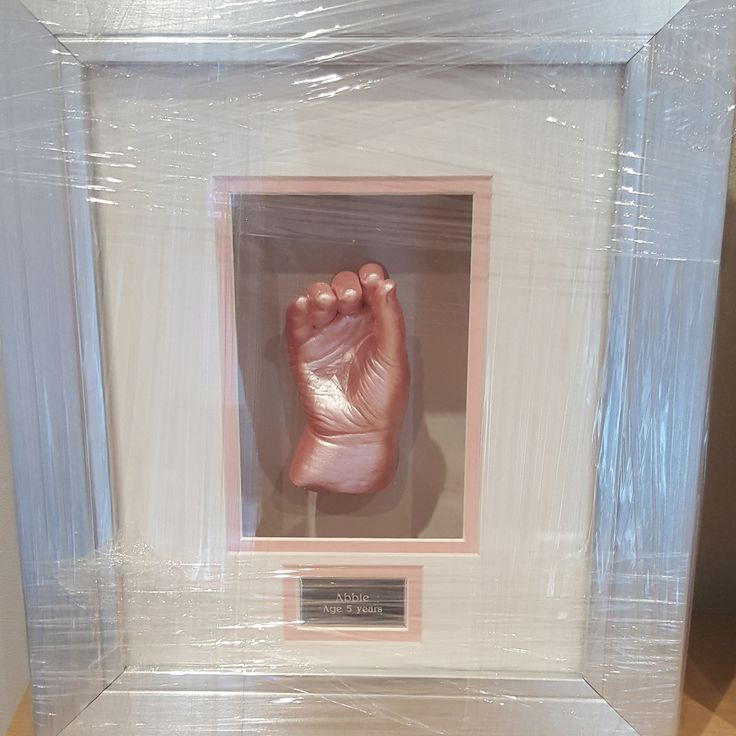 A framed hand cast, with a beautiful pink finish. Find out more at: https://babycastsandprints.co.uk/