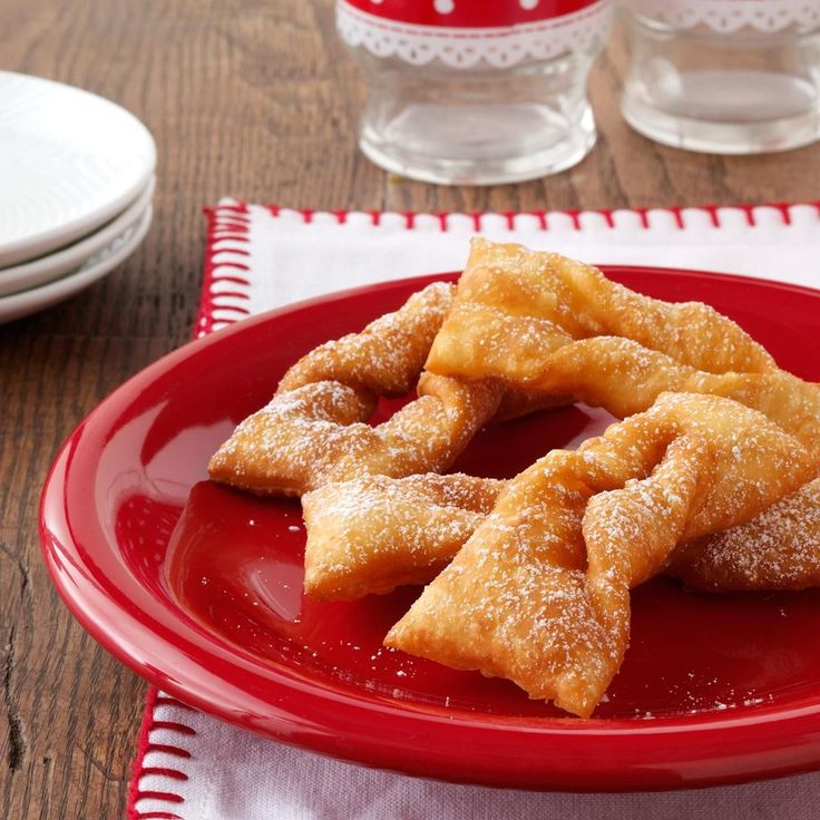 Grandma's Polish Cookies Recipe -This traditional khruchiki recipe has been handed down through my mother's side from my great-grandmother. As a child, it was my job to loop the end of each cookie through its hole. —Sherine Elise Gilmour, Brooklyn, New York