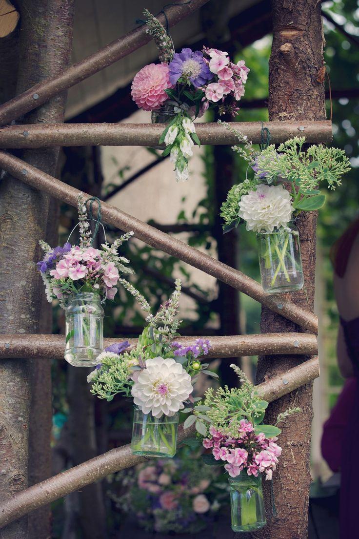 Flowers in jars hanging from wood  http://sarahannweddings.com/