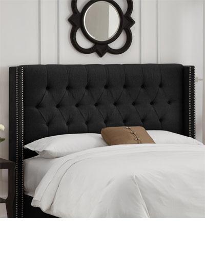 Black headboard, crisp white linens, needs a less wimpy accent pillow though :)