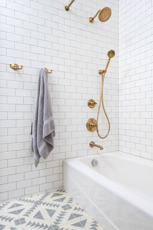 Renovated Bathroom With White Subway Tile, White And Grey Tile Floor