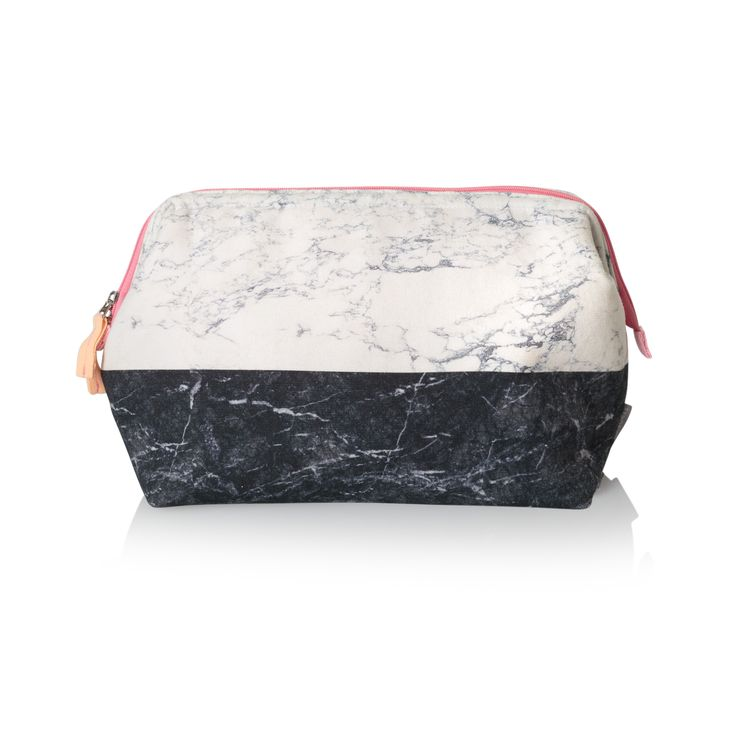 Buy the Black & White Marble Wash Bag at Oliver Bonas. Enjoy free worldwide standard delivery for orders over £50.