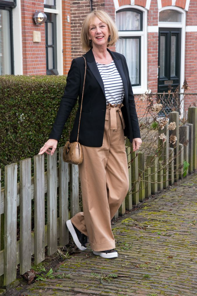 Joline Jolink is a Dutch designer.who designed these wide khaki trousers and the blue and white striped top,