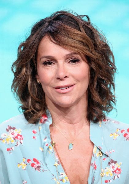 Jennifer Grey Photos Photos - Actress Jennifer Grey speaks onstage at the 'Red Oaks' panel discussion during the Amazon portion of the 2016 Television Critics Association Summer Tour at The Beverly Hilton Hotel on August 7, 2016 in Beverly Hills, California. - 2016 Summer TCA Tour - Day 12