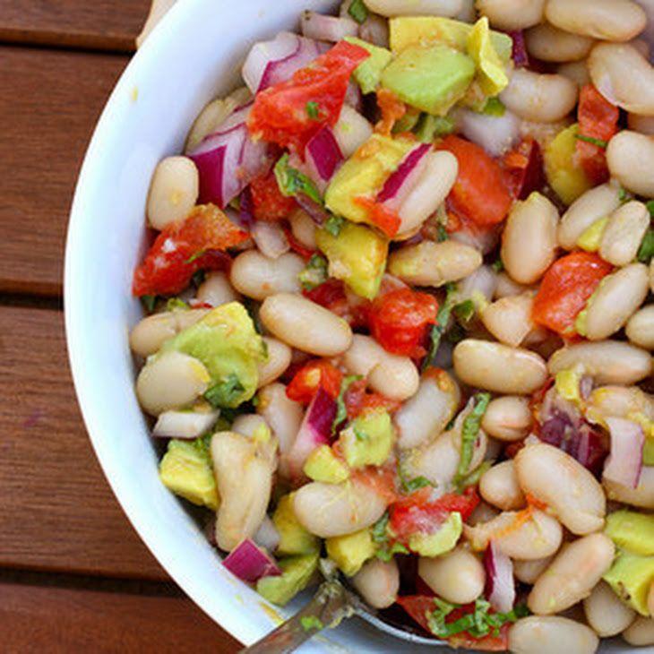 White Bean Salad with Lemon Vinaigrette Recipe Salads with lemon juice, olive oil, fresh basil, garlic, lemon, mustard, pepper, salt, cannellini beans, tomatoes, avocado, sweet onion
