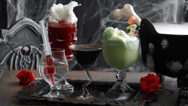 Recipe with video instructions: Have a spooky good Halloween party with these four deadly delicious elixirs sure to scare up a crowd. Ingredients: 3 ounces blood orange juice, 2 ounces sour cherry juice, 1/2 ounce sweet and sour mix, 3 ounces vodka, 1 cup white cotton candy (found at your local candy store)