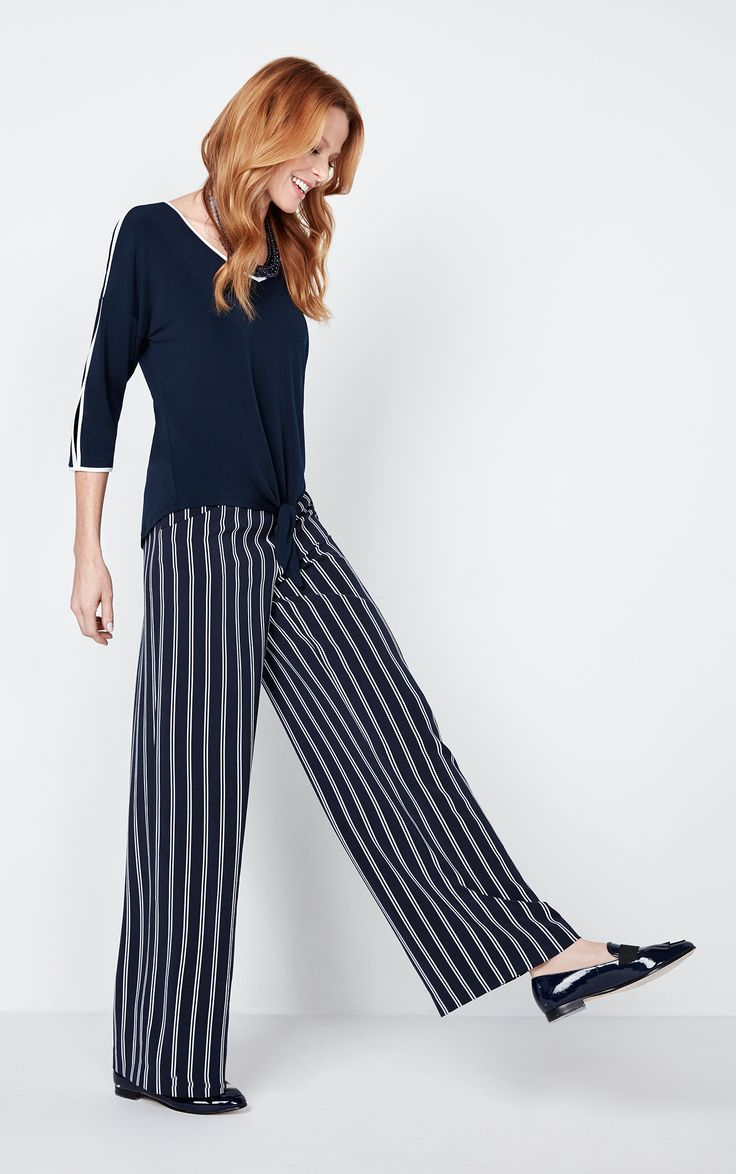Our trendy wide leg pant flows elegantly with every step you take while the striped pattern elongates your look to keep you looking sleek and chic.