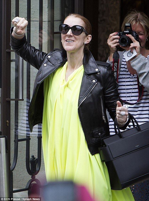 Feeling fine: Celine Dion looked in high spirits as she leftthe Royal Monceau hotel in Paris on Monday