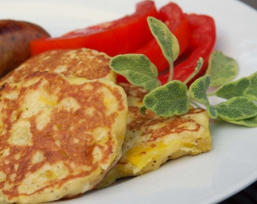 squash patties -- yellow squash, 1 egg, 1 tbsp sugar, 1 tsp salt, 1/2 c. self-rising flour, 1/4 c. sauteed chopped onions, 1/4 c. sauteed red or green peppers, ground pepper