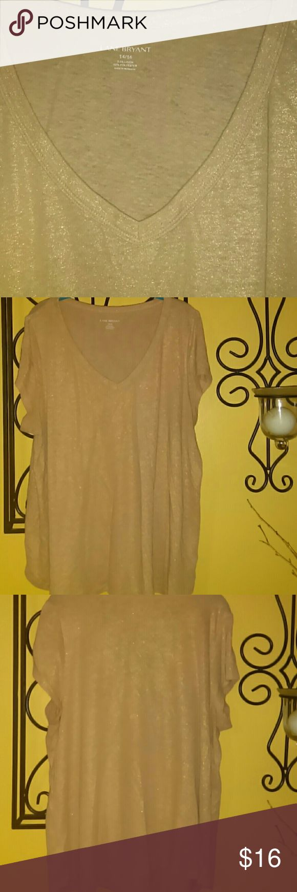 Lane Bryant metallic gold tee Good used condition, deep V-neck, shiny threads! Purchased in the fall of 2015, gently used one season. Size 14/16, 24 flat bust, 26 in long. Some piling in the armpit area. Lane Bryant Tops Tees - Short Sleeve