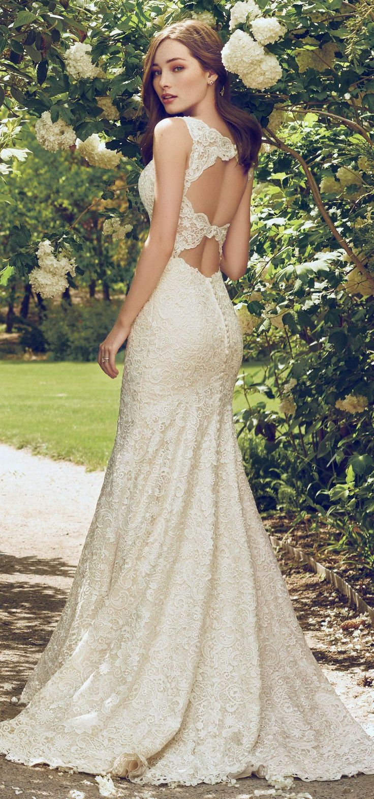 """Oh what a stunning back! """"Hope"""" from @maggiesottero #RebeccaIngram collection features a stunning double-keyhole back. #bridal #wedding #weddingdress #weddinggown #bridalgown #dreamgown #dreamdress #engaged #inspiration #bridalinspiration #weddinginspiration #keyhole #weddingdresses #lace #romantic"""