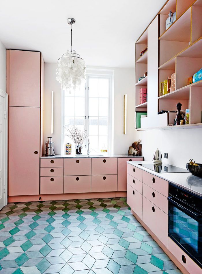 Pink kitchen cabinets and blue tiled floor