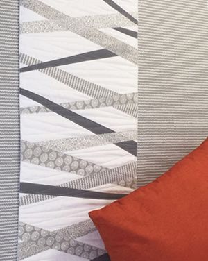 Learn how to make this pretty, minimal Urban Scandinavian Winter Runner for your bed or table. Kirstyn Cogan, author of Urban Scandinavian Sewing and the designer behind P&B Textile's Urban Scandinavi