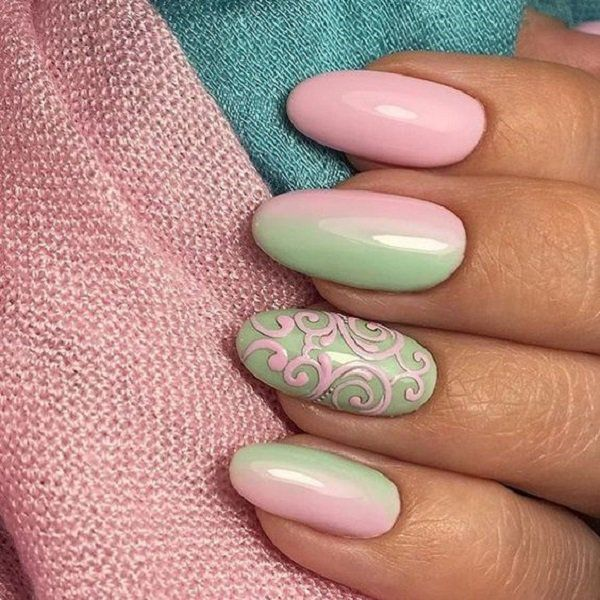 The combination of two gentle colors, gentle ombre on two fingers is very interesting. And for pattern on the ring finger nail you will need a little bit more experience in drawing patterns.