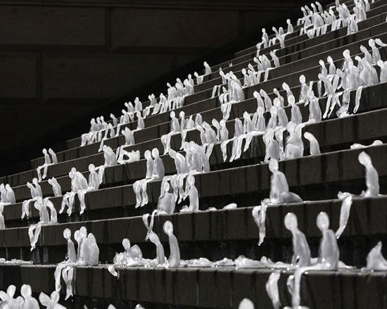 'melting men' by nele azevedo. this amazing installation of 1,000 melting men was done in collaboration with the WWF to highlight global warming.