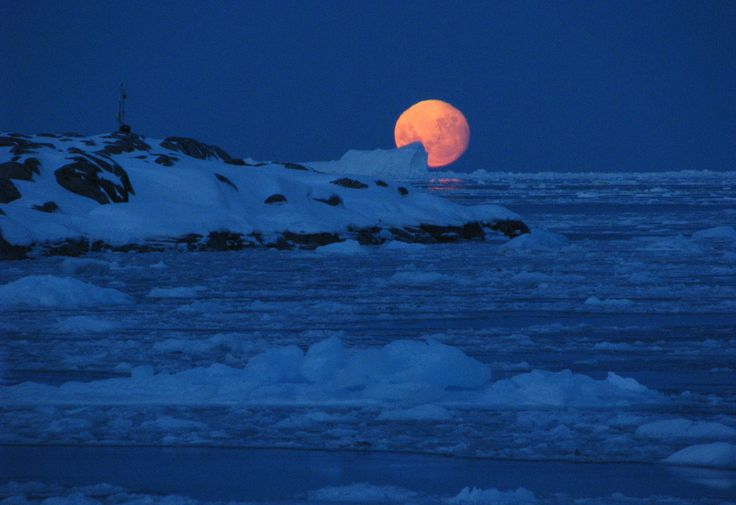 The moon setting behind Bonaparte Point, Anvers Island on September 2, 2009. (National Science Foundation/Ken Keenan)